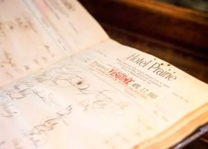 Close-up of old hotel register