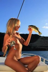 Artistic shot of a hot blonde woman fishing