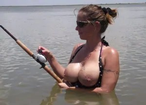 Boobs out fishing topless