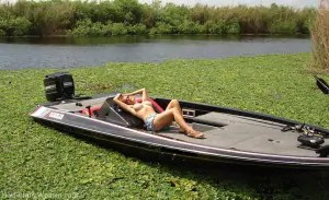 Vicki showing off her big boobs on a Bass boat.