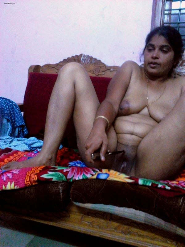 Mallu teacher sitting naked on sofa showing boobs playing with pussy pics