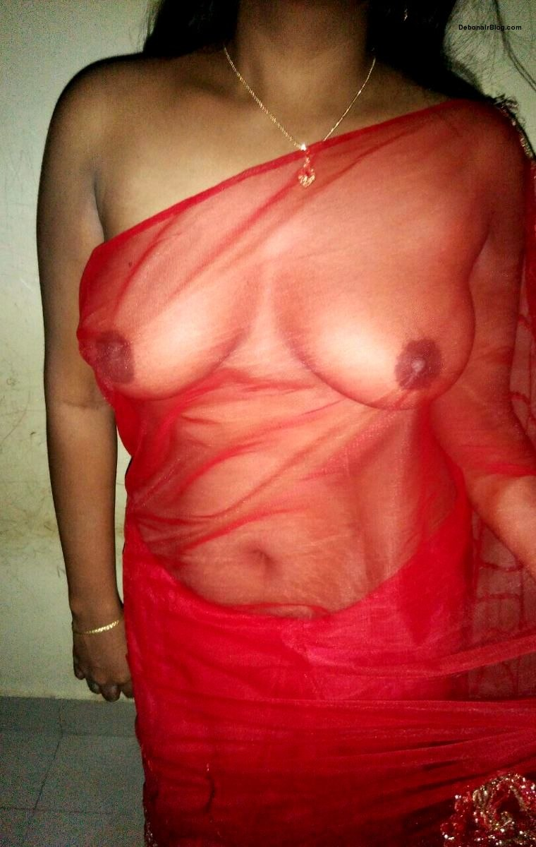 South Indian wife in transparent red saree showing boobs pics