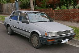 1987 Toyota Corolla, four-door, sitting on side of street