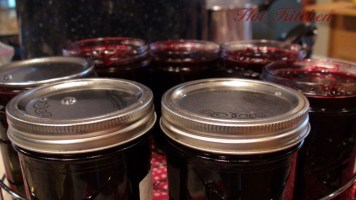 Filling the jars, hot kitchen jam recipe