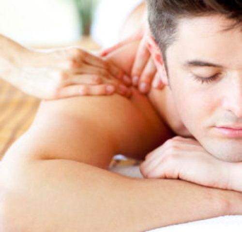 Close-up of an attractive man having a back massage in a spa center