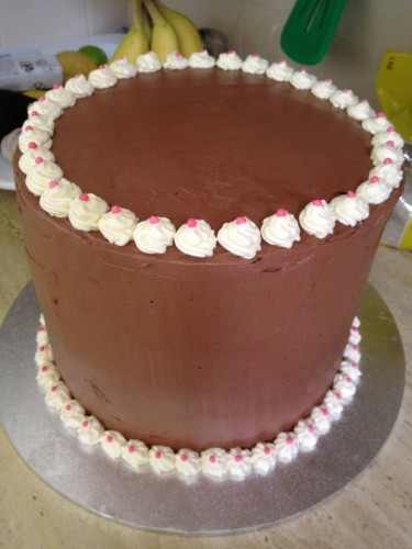Neapolitan cake with chocolate butter cream icing