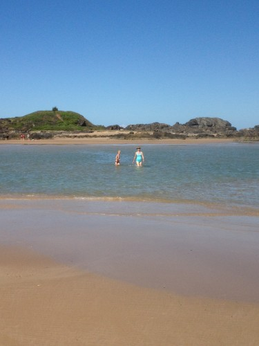 Walking back across the channel after exploring rock pools and climbing to the summit