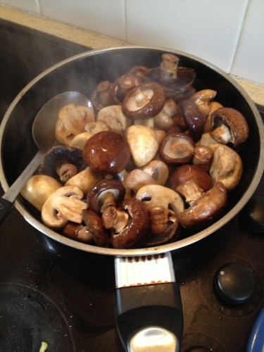Sauteing the mushrooms in butter - no need to chop them, they are better kept whole