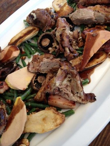 The main course of green beans, confit goose legs, pancetta batons, mushrooms, foie gras and toasted walnuts