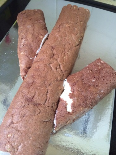 Turning 2 chocolate rolls into a log