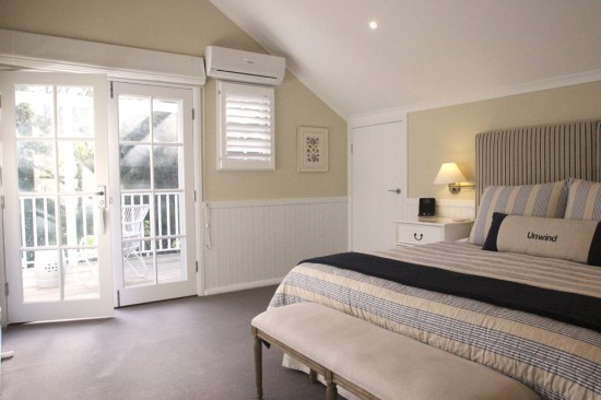 Master bedroom in the deluxe cottage