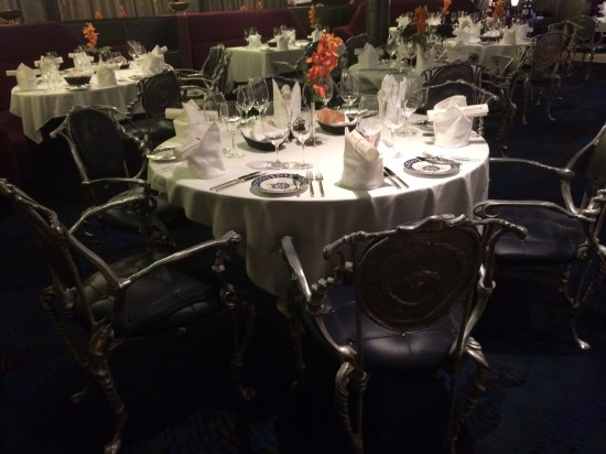 A beautifully set table with extremely ornate chairs