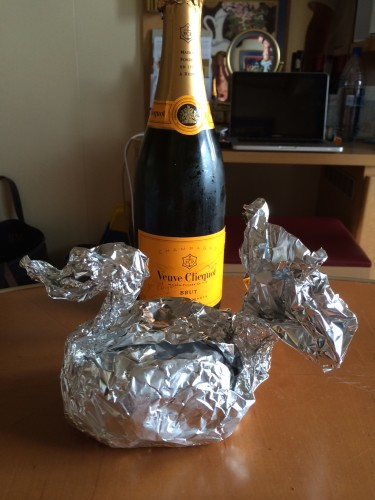 The champagne from our three children but organised by our one daughter (we didn't open it that night as I already had a bottle of Mumm), and our dessert that had become a swan.