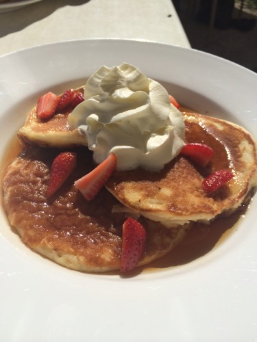 Pancakes with maple syrup, whipped cream and strawberries:  $10.00