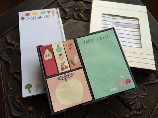 A shopping list pad, two tea-towels and some post-it notes