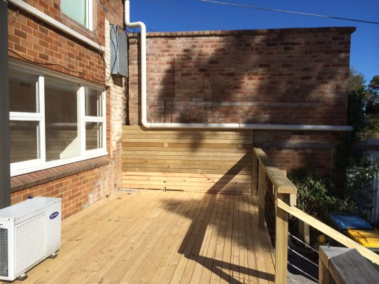 A new deck.  Pipe still to be removed