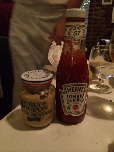 Condiments brought to the table for the burger