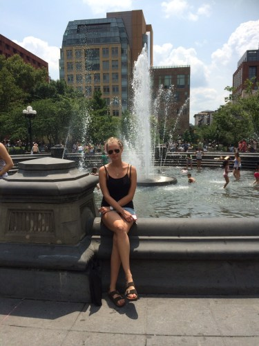 Sitting by the fountain at Washington Square