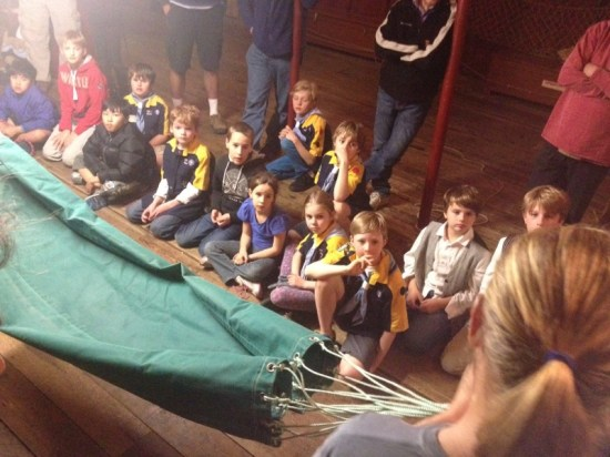 Learning how to set up their hammocks