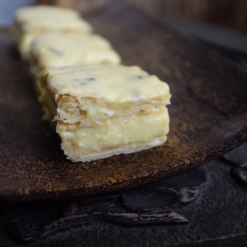 Puff pastry, vanilla custard and passionfruit icing
