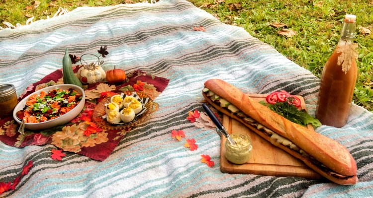A picnic meal on a blanket including