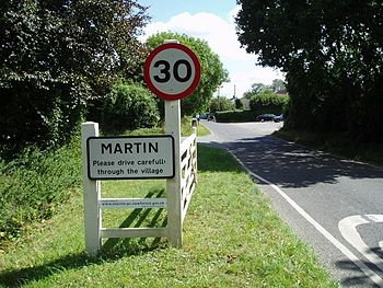 English: Martin. The village sign now includes...