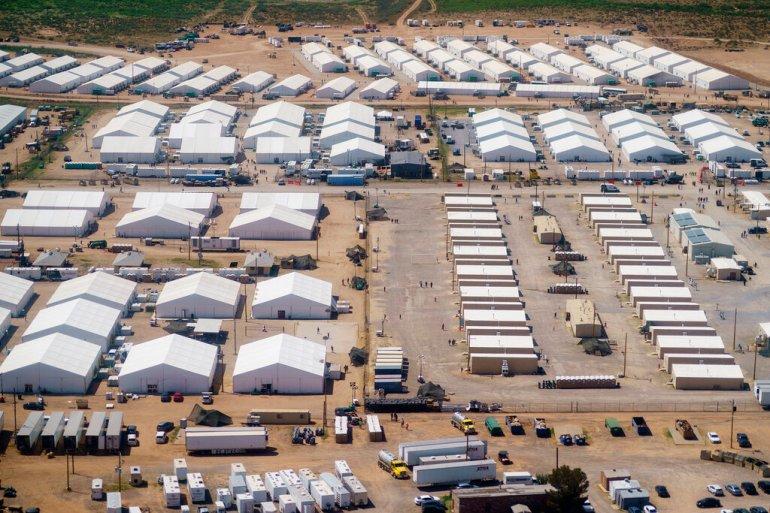 美安置阿富汗难民军事基地首开放 媒体不得与难民交流