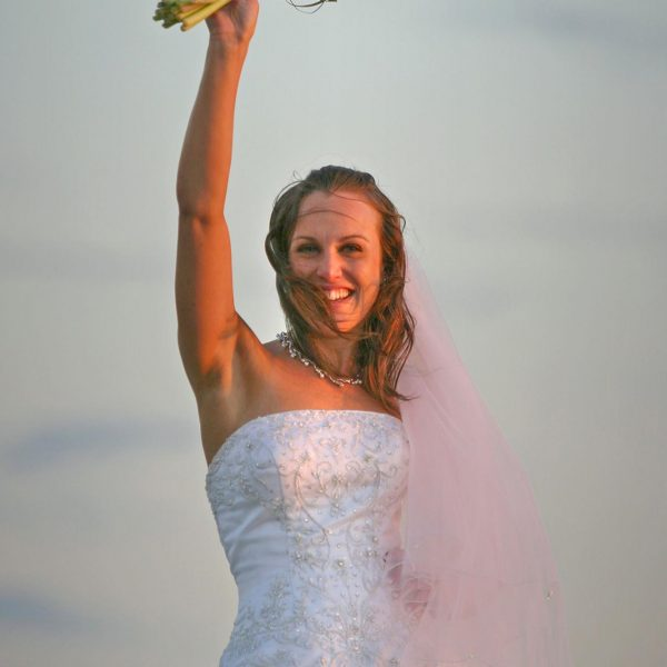 wedding portrait commercial photographers An awesome bride photo full of joy by Ian Anderson of Hotshots Photography in New Zealand