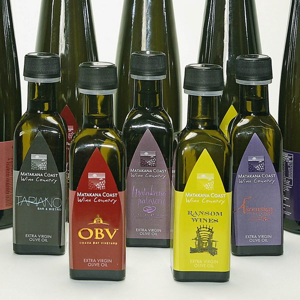Olive Oil bottles pose for Commercial Photography at Hotshots Creative in Warkworth