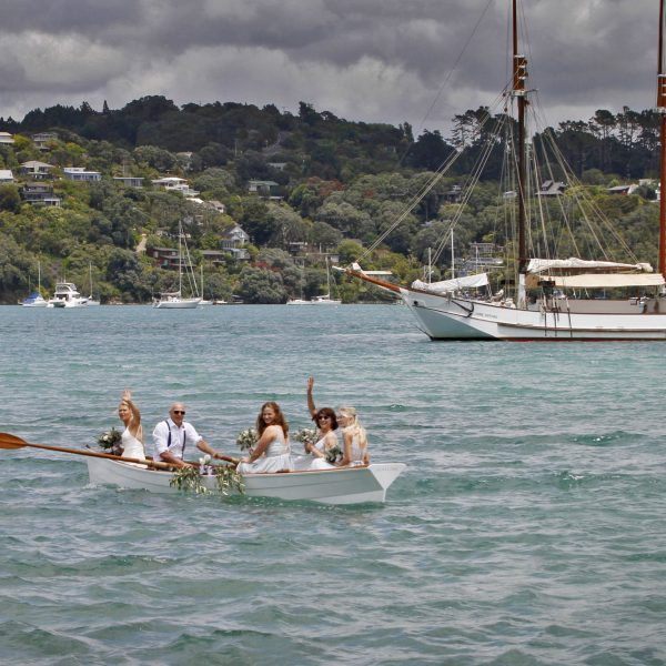 Wedding Photography Bridal party in punt boat and the Jane Gifford beyond