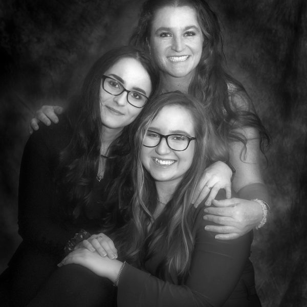 Hotshots Family Portrait Photographers, Auckland NZ. Black and white studio portrait of a mother and her daughters.