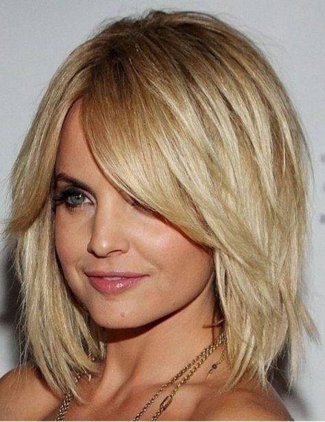 Blonde Shoulder Length Haircut with Bangs