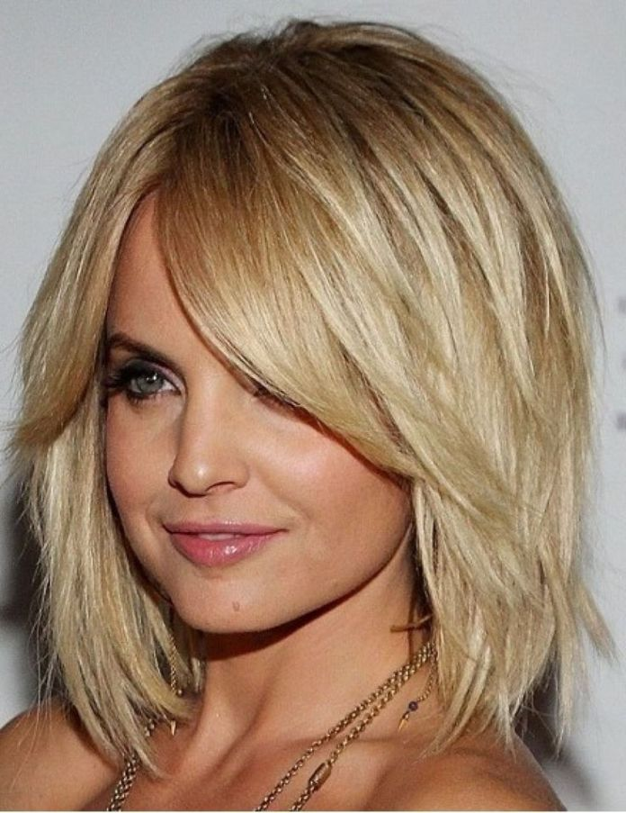 Blonde Shoulder Length Haircut with Bangs