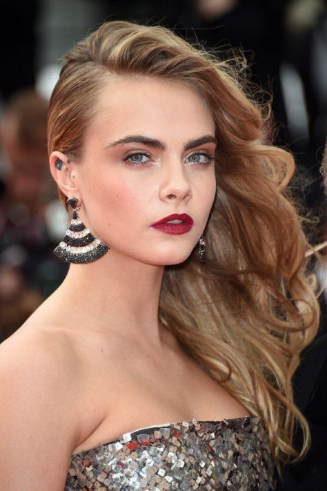Cara Delevingne Wavy Side Swept Hairstyle