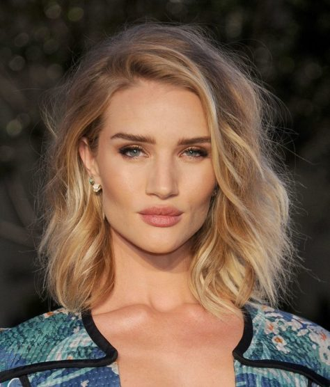 Blonde Layered Haircut with Choppy Ends