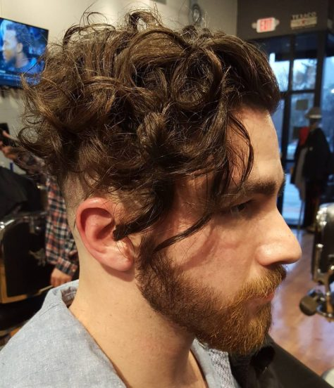 Long Curly Undercut Hairstyle for Men