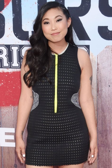 Awkwafina's Side Swept Long Hair with Curls