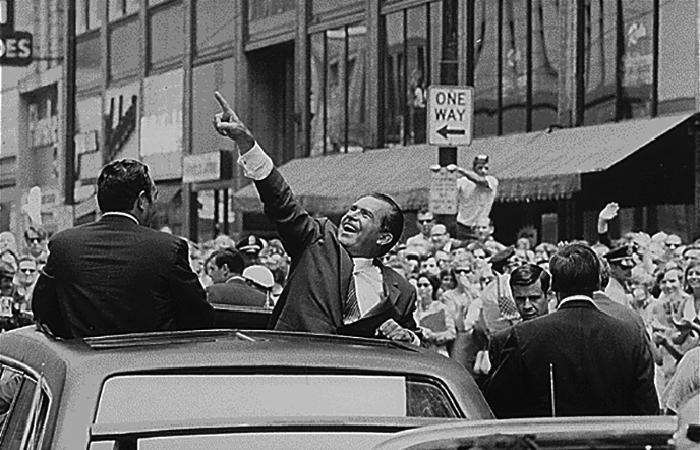 Richard Nixon pointing at the sky