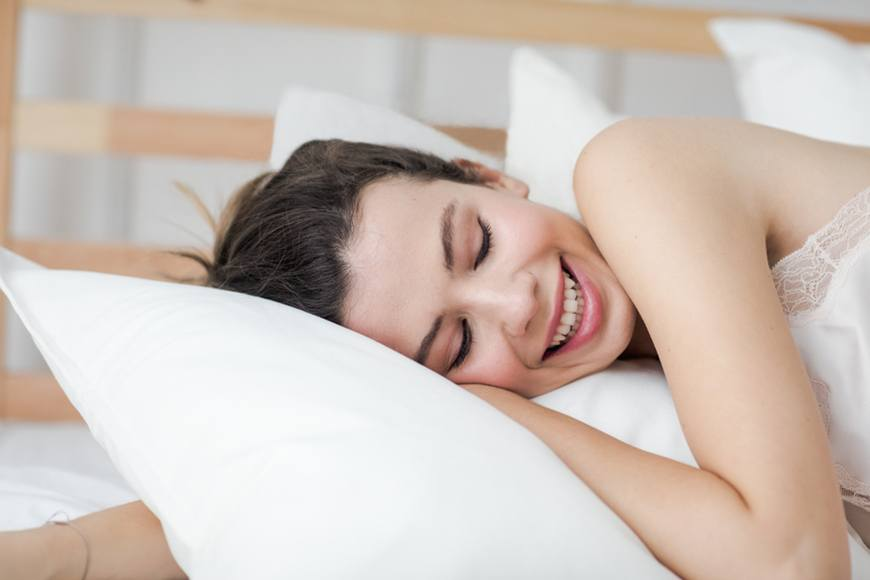 women sleeping on silk pillowcase