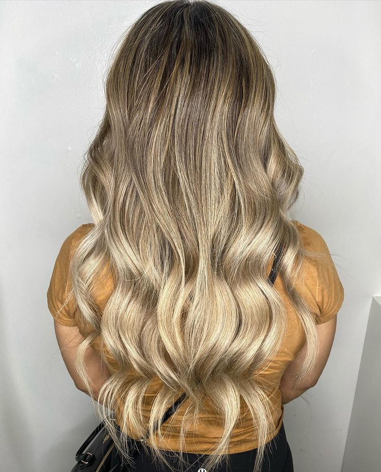 22 Inch Blonde Balayage I Tip Hair Extensions Installed On Women