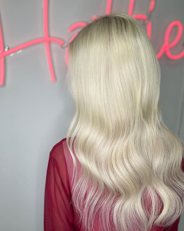 blonde women with beautiful sew in hair waved