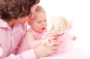 parent-baby-playing-with-doll