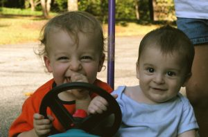 toddlers in push car