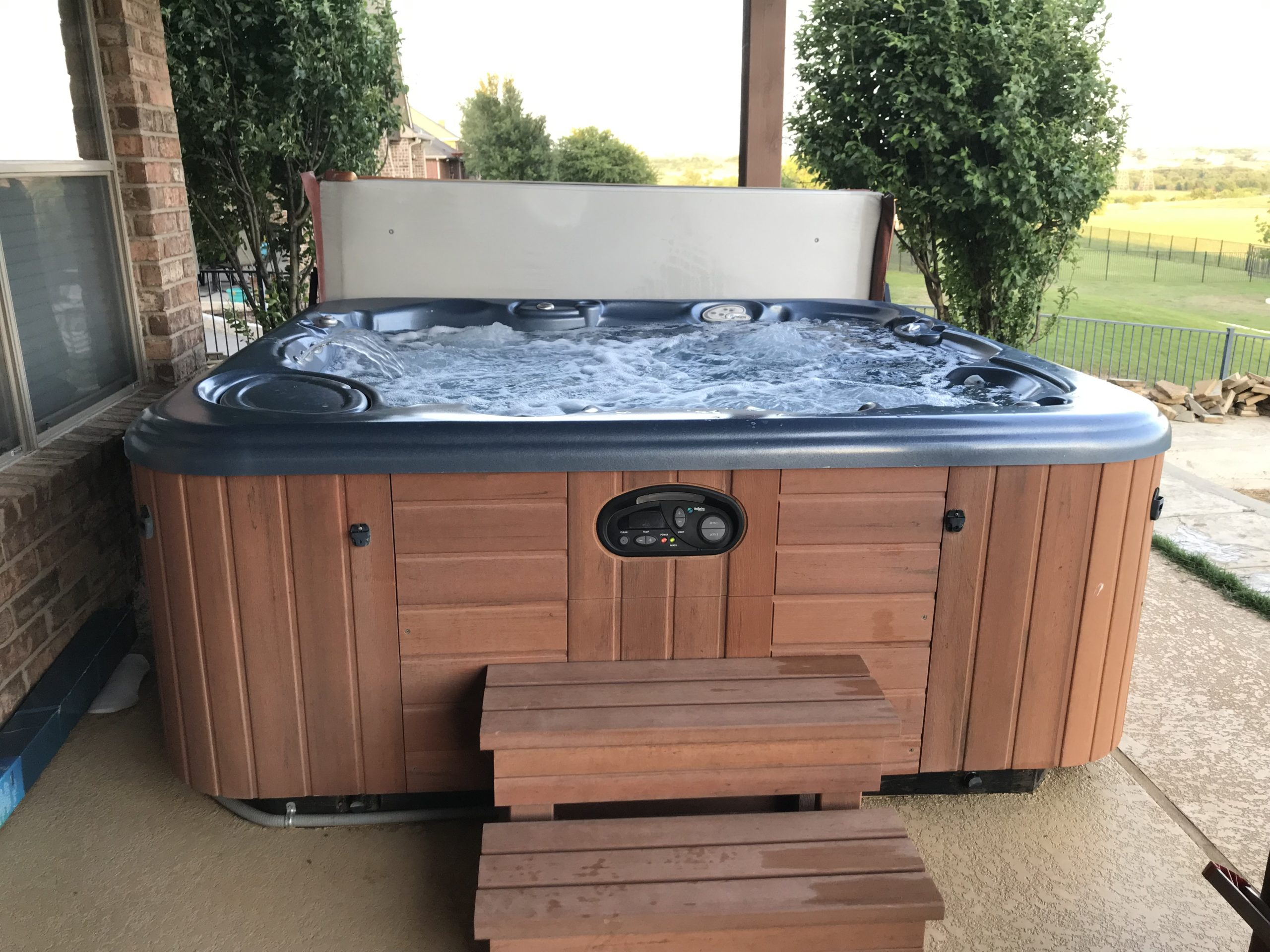 Hot Springs Envoy 5 person Hot Tub w/ steps and cover cradle cover lifter