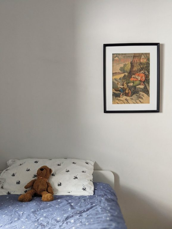 Augie's room. The artwork was a print Bree and Trin picked up in Lyon at the book market.