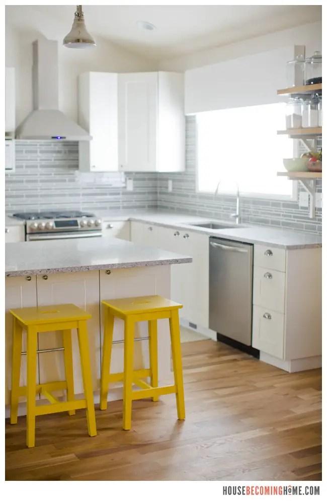 DIY Kitchen Renovation White Cabinets, Quartz Countertops, Yellow Stools