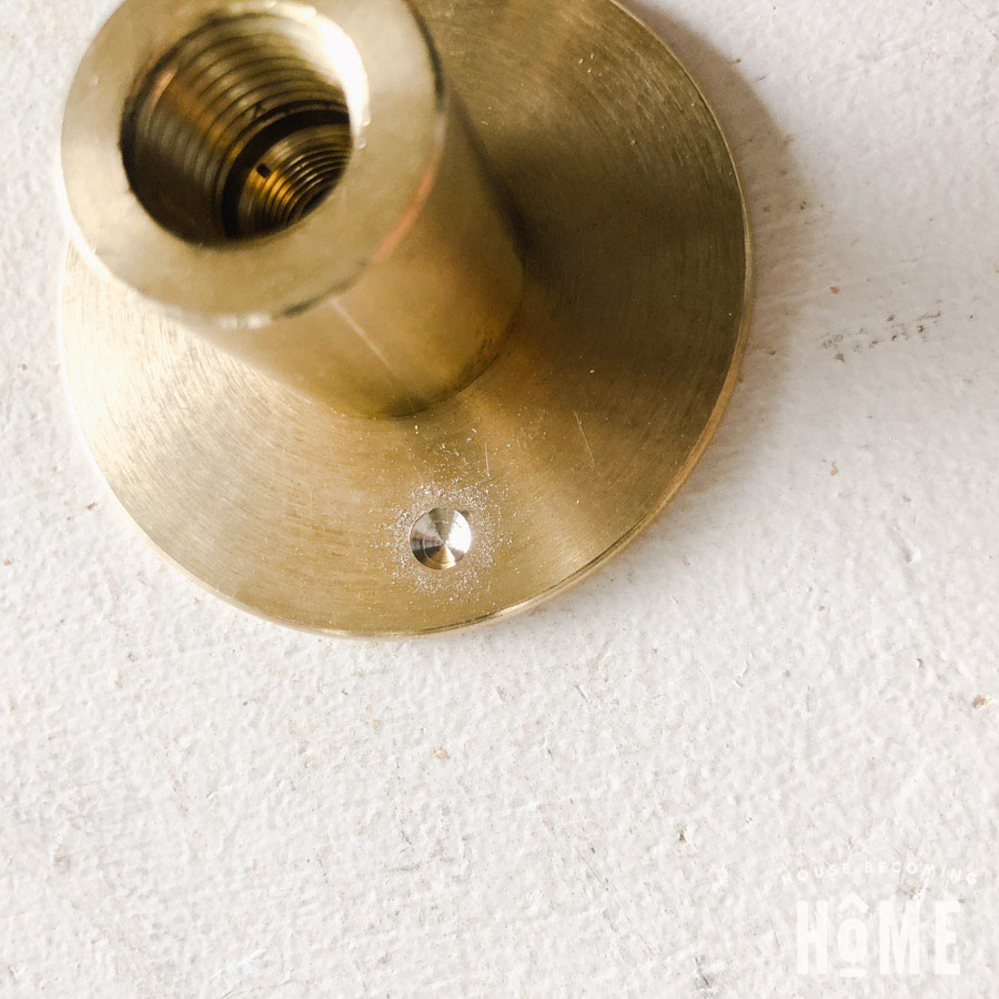 Begin Drilling Hole in Check Ring of Toilet Paper Holder