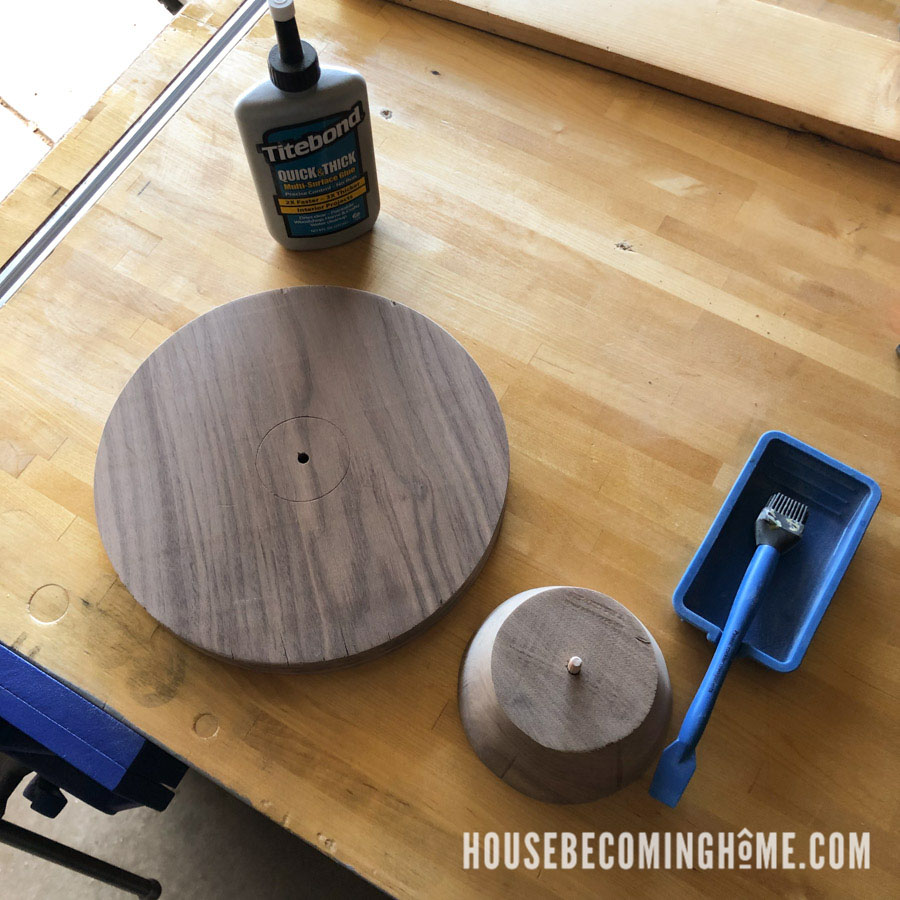 Putting the wood cake stand together with wood glue and a dowel