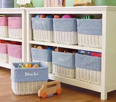 storage boxes in child's room to keep things organized