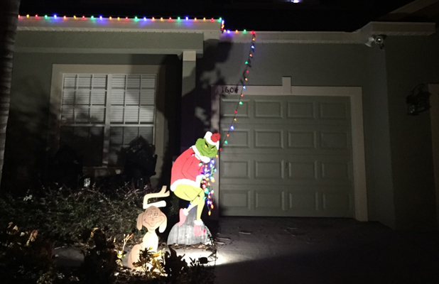 Grinch Stealing Christmas Lights Off House